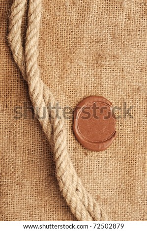 wax seal and rope on sackcloth material - stock photo