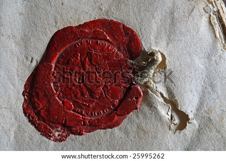 wax seal on old grey paper - stock photo