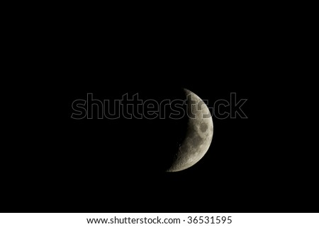 Waxing crescent moon closeup isolated against a black night sky - stock photo