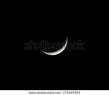 Waxing Crescent Moon with craters - stock photo