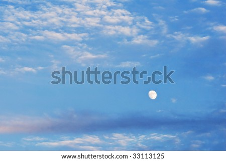 Waxing Gibbous Moon in Cloudscape - stock photo