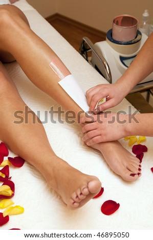 Waxing in spa salon - stock photo