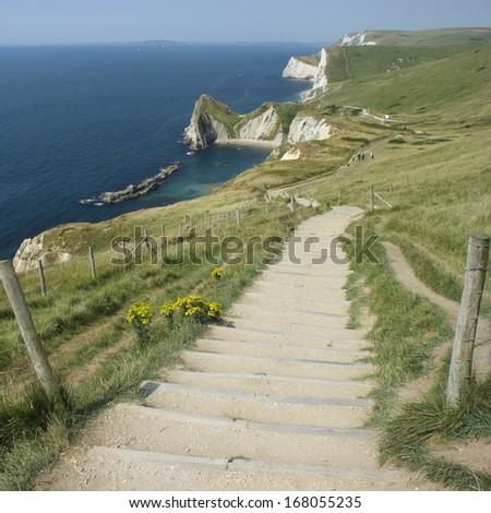 way down to Durdle Door beach - stock photo