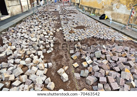 way of cobble stones under construction - stock photo