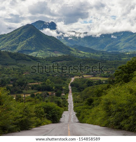 Way to beautiful mountains,Road - stock photo