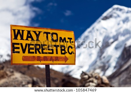 Way to Mt. Everest Base Camp signpost in Himalayas, Nepal - stock photo