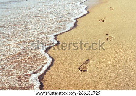 way to new life, wellbeing concept, Footprints in the sand - stock photo