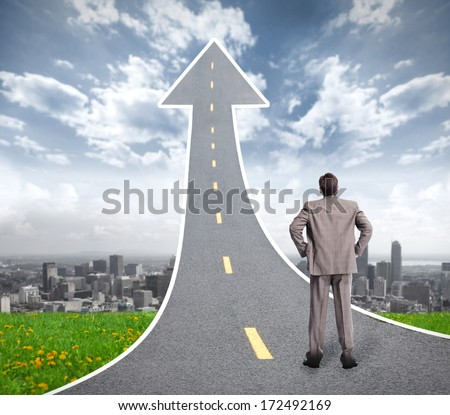 Way to success. Business man looking for future. - stock photo
