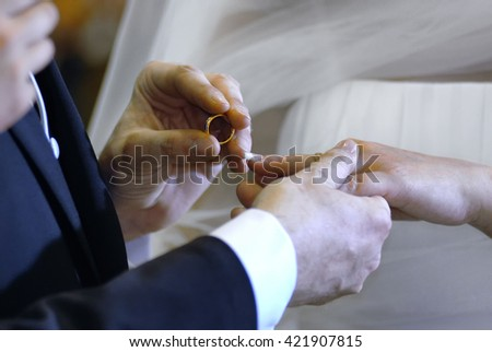 Wdding hands between husband and wife with ring during the celebration of marriage