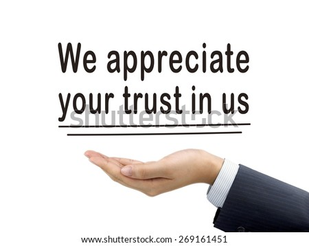 we appreciate your trust in us holding by businessman's hand over white background - stock photo