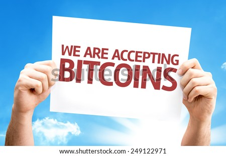 We Are Accepting Bitcoins card with sky background - stock photo