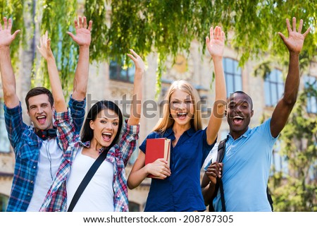We are happy! Four happy young people making selfie while standing close to each other outdoors - stock photo