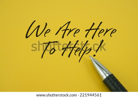 We Are Here To Help! note with pen on yellow background