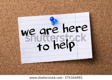 We are here to help - teared note paper  pinned on bulletin board - horizontal image - stock photo