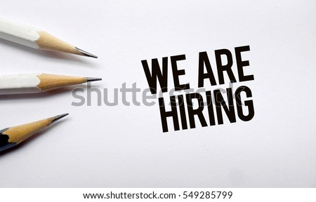 We are hiring memo written on a white background with pencils