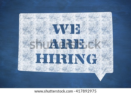 We are hiring message against blue chalkboard