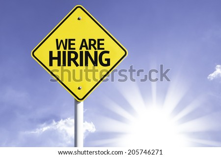 We are Hiring road sign with sun background - stock photo