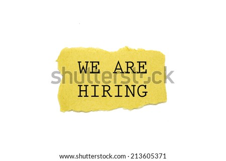 we are hiring! text written on torn brown paper - stock photo