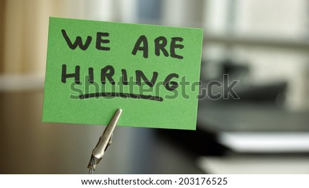 We are hiring written on a memo at the office - stock photo