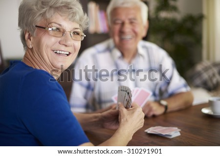 We are never too old to play cards - stock photo
