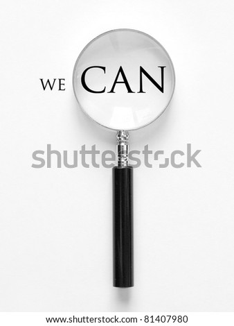 we can and magnifying glass - stock photo