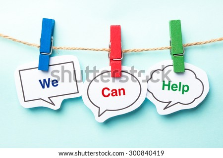 We can help bubble with clip hanging on the line with blue background. - stock photo