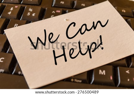 We can help Concept on black keyboard note - stock photo