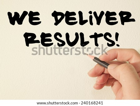 we deliver results text write on wall