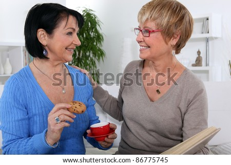 We get together and have tea. - stock photo