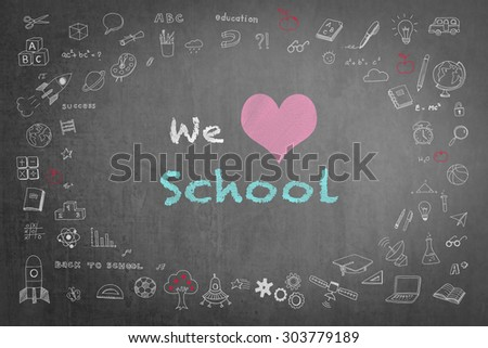 We love school message  on black chalkboard with doodle free hand sketch chalk drawing on the frame: Teachers day concept: Students sending love message to school teacher on special occasion       - stock photo