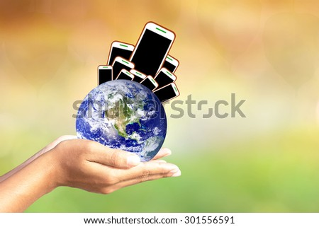 We love the world of ideas.world concept of waste electronic devices the world over. Elements of this image furnished by NASA. - stock photo