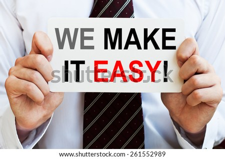 We make it easy! phrase written on a card in businessman hands - stock photo