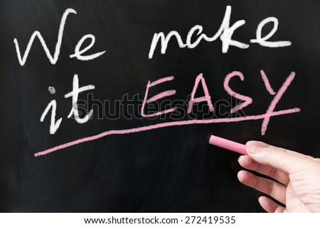 We make it easy words written on blackboard using chalk - stock photo