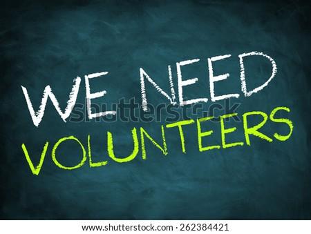 we need volunteers - chalkboard concept - stock photo