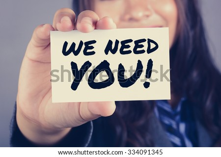 WE NEED YOU! message on the card shown by a businesswoman, vintage tone - stock photo