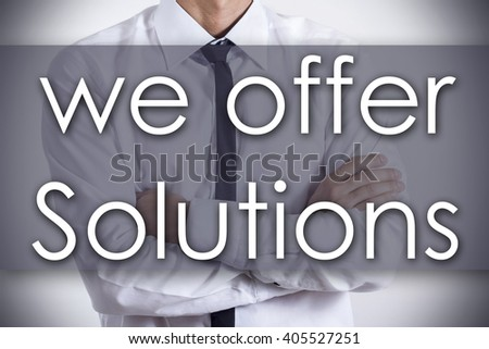 We offer Solutions - Closeup of a young businessman with text - business concept - horizontal image
