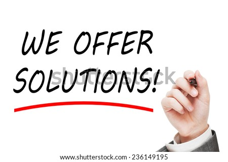 We offer solutions! Male hand writing a message text isolated on white background - stock photo