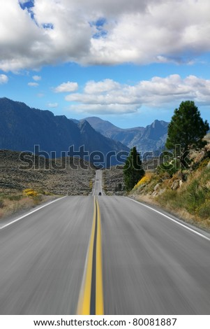We're going at high speed through a picturesque steppes to the far mountains. In the mountains here and there is snow - stock photo