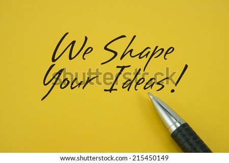 We Shape Your Ideas! note with pen on yellow background - stock photo