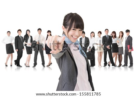 We want you. Asian business woman point at the camera in front of her team. Isolated on the white background. - stock photo