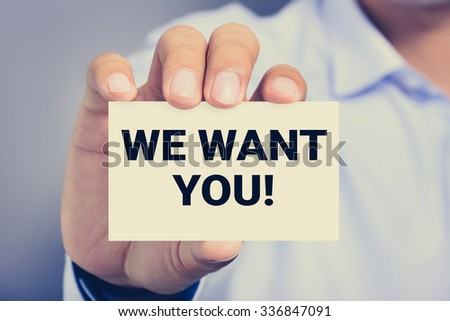 WE WANT YOU! message on the card shown by a man, vintage tone - stock photo