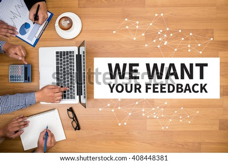 WE WANT YOUR FEEDBACK Concept Business team hands at work with financial reports and a laptop - stock photo