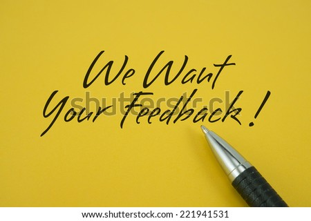 We Want Your Feedback! note with pen on yellow background