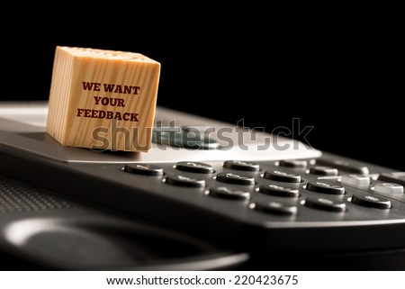 We Want Your Feedback written on a wooden block resting on a computer keyboard in a concept of rating, opinion, monitoring, and regulation of a business. - stock photo