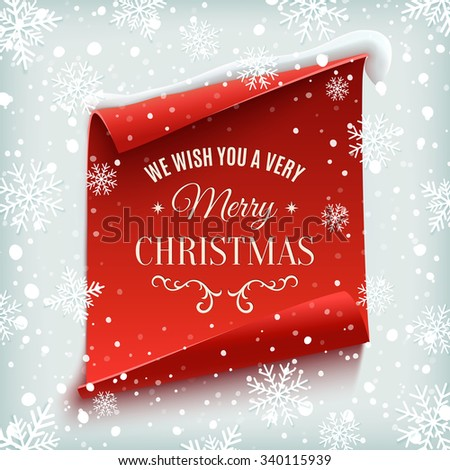 We wish you a Very Merry Christmas, greeting card. Red, curved, paper banner on winter background with snow and snowflakes. - stock photo