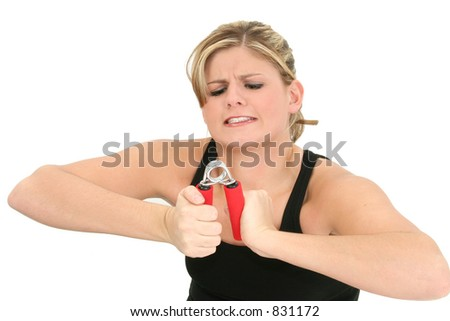 Weak young woman struggling with handgrip exerciser. - stock photo