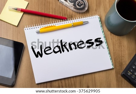 Weakness - Note Pad With Text On Wooden Table - with office  tools - stock photo