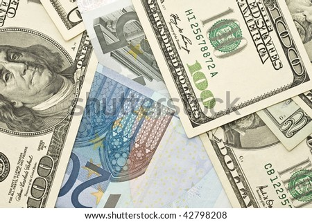 Wealth and success - US dollar and Euro banknotes - stock photo