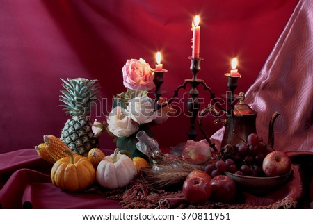 Wealth concept on still life art photography with growing fruit under candle light - stock photo