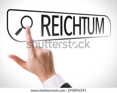 Wealth (in German) written in search bar on virtual screen - stock photo